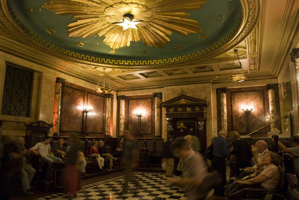 A Masonic lodge at Andaz Hotel in London. Checkerboard floor, twin pillars and a giant blazing star on the ceiling.