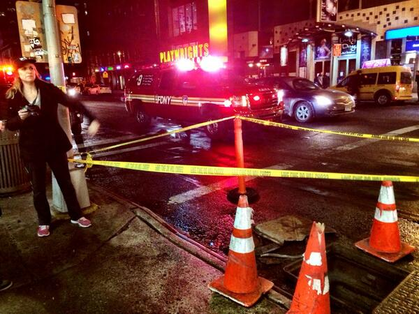 Manhole covers exploded on 42nd Street in Hell's Kitchen, (Manhattan) New York. 2-02-2014.