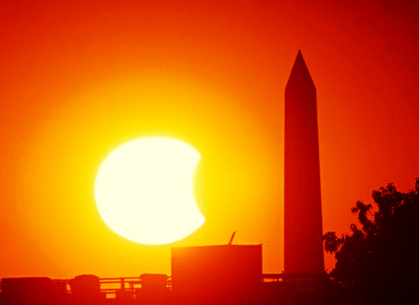 10-23-2014: Original Photo by - philliefan99 – take a bite out of the monument A partially eclipsed setting sun approaches the Washington Monument on