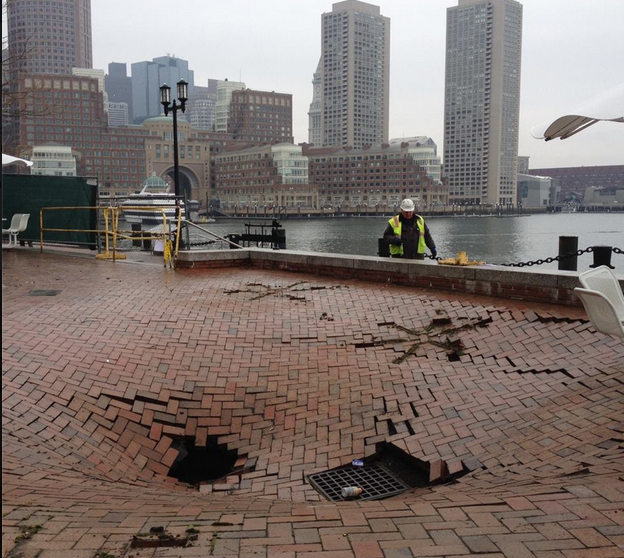 3-12-2014: A sinkhole has developed behind the federal courthouse in South Boston.