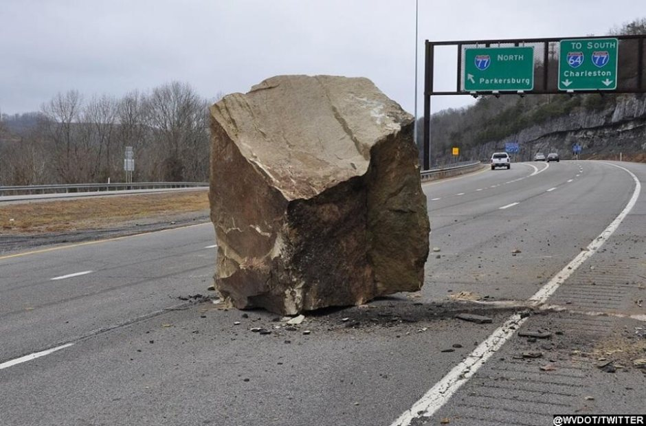 "West Virginia: We've been dealing with wet roads and icy conditions today... but imagine dealing with falling boulders! ...That's what happened in West Virginia this morning when a boulder ""as large as a car"" broke off a mountain and fell onto an Interstate, blocking the right lane. Crews are on scene, waiting for equipment to break the rock apart. 2-06-2014"