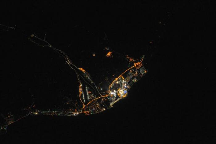 2-12-2014:  AMAZING! Photo taken by the ISS crew shows Sochi Olympic Park - Fisht Stadium and the flame are visible. The Games are now into Day 5, having officially opened on Friday.