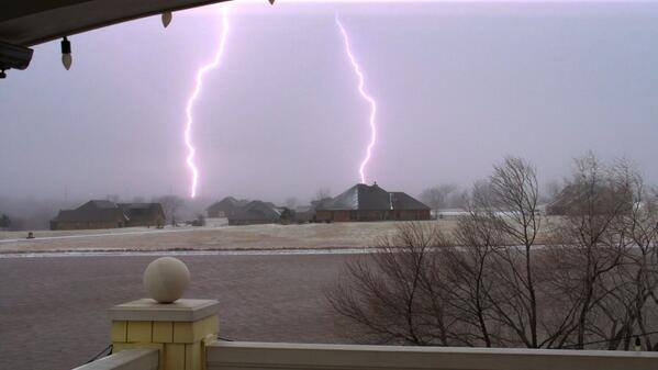Incredible display of cloud to ground lightning during heavy snow and sleet in Norman. 3-2-2014