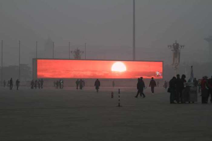 China - Smog in Beijing Is So Awful You Have to Catch the Sunrise on a Big Screen! In the airpocalypse, fake sunrises are a thing. This LED screen displays the rising sun in Beijing's Tiananmen Square, which is shrouded in heavy smog on Jan. 16, 2014. Air pollution in the Chinese capital reached new, choking heights on Thursday. Those who still felt the urge to catch a glimpse of sunlight were able to gather around the city's gigantic LED screens, where this glorious sunrise was broadcast as part of a patriotic video loop. Read more: Beijing's Televised Sunrise | TIME.com http://world.time.com/2014/01/17/beijing-smog-combatted-with-televised-sunrises/#ixzz2qgmzJplW