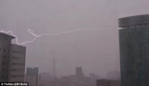 Lightning strikes: This dramatic picture shows the moment a bolt of lightning struck a building in Birmingham as fierce storms battered Britain. 1-25-2014