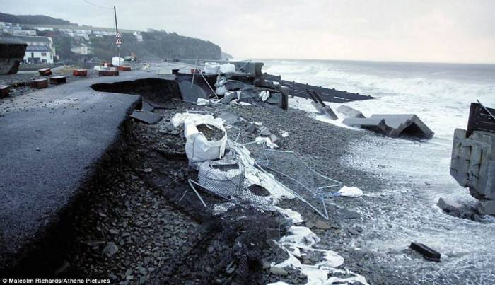 Significant damage to the coastal areas in Amroth, west Wales, UK where parts of the road were ripped up due to powerful sea waves and storm surge smashing onshore. All as a result of damaging winds associated by cyclone Ulla.