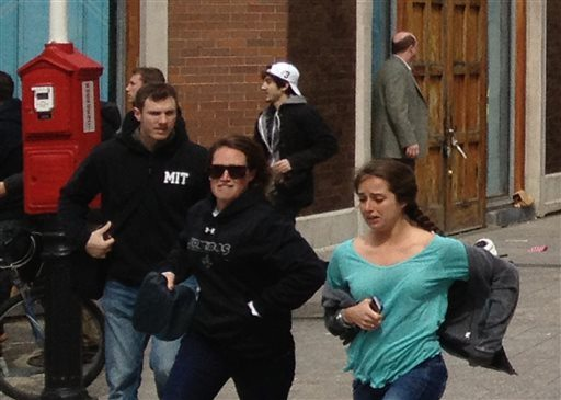 This Monday, April 15, 2013, shows a man who was dubbed Suspect No. 2 in the Boston Marathon bombings by law enforcement, in the upper center of the frame, wearing a white baseball cap, walking away from the scene of the explosions. The FBI identified him as 19-year-old college student Dzhokhar Tsarnaev, who along with his brother Tamerlan, 26, previously known as Suspect No. 1, killed an MIT police officer, severely wounded another lawman and hurled explosives at police in a car chase and gun battle during a night of violence, early Friday, April 19, 2013. Tamerlan Tsarnaev was killed overnight, officials said, while his brother Dzhokhar remains at large. (AP Photo/David Green)