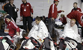 Runners cover themselves with foil blankets as they receive medical attention in the medical tent after running in the Boston Marathon on April 16, 2007.
