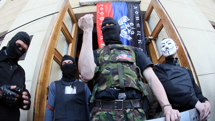 4-27-2014: Activists stand guard outside a regional television station after it was seized by pro-Russian separatists, in the eastern Ukrainian city of Donetsk.  (AFP Photo / Alexander Khudoteply)