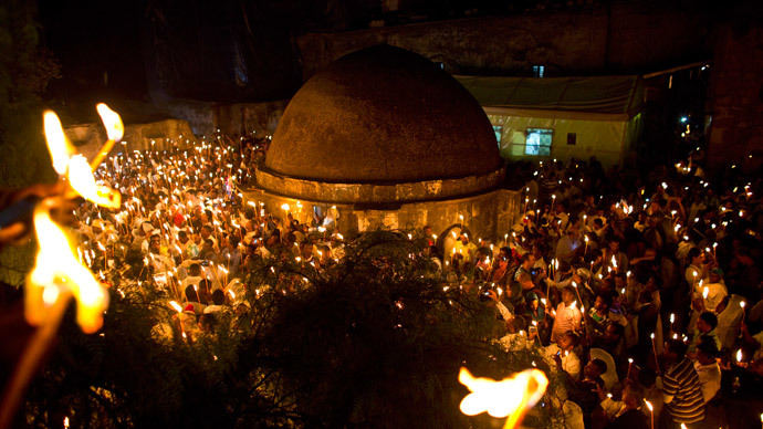 Ethiopian Orthodox worshippers hold candles during the Holy Fire ceremony at the Ethiopian section of the Church of the Holy Sepulchre in Jerusalem's Old City, April 19, 2014.(Reuters / Nir Elias)