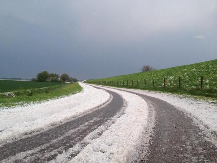4-25-2014: a lot of hail has been reported from the Netherlands today as a broken line of storms moved across the country. Source: twitter @MichaelvdPoel