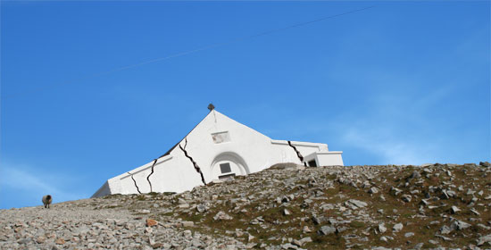 """Croagh Patrick or the Reek, is a pilgrimage site in County Mayo in Ireland. On the top of this 764 metres (2,507 ft) sits a small church called """"Teampall Phadraig""""."""