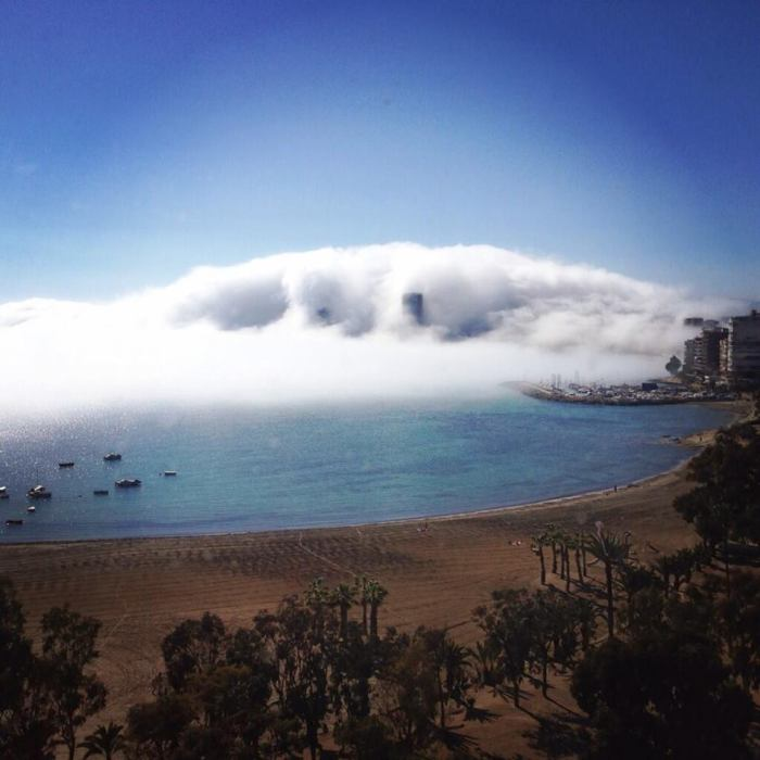 "4-7-2014: dense fog / low cloudiness in Alicante, Spain today. The fog was literally ""eating"" the city! Source: Martha Strand on twitter via Cazatormentas.Net"