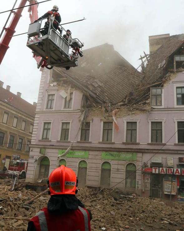4-26-2014: A FOUR-STOREY building has collapsed in Vienna after an unexplained explosion left rescuers fearing for people who may be trapped inside.