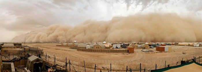 5-16-2014: Giant Sandstorm Looms Over Base in Afghanistan A sandstorm approaches Camp Bastion, Britain's main military base in Afghanistan, on Friday. Dust storms are a common occurrence in Afghanistan and within an hour the worst of the storm had passed.