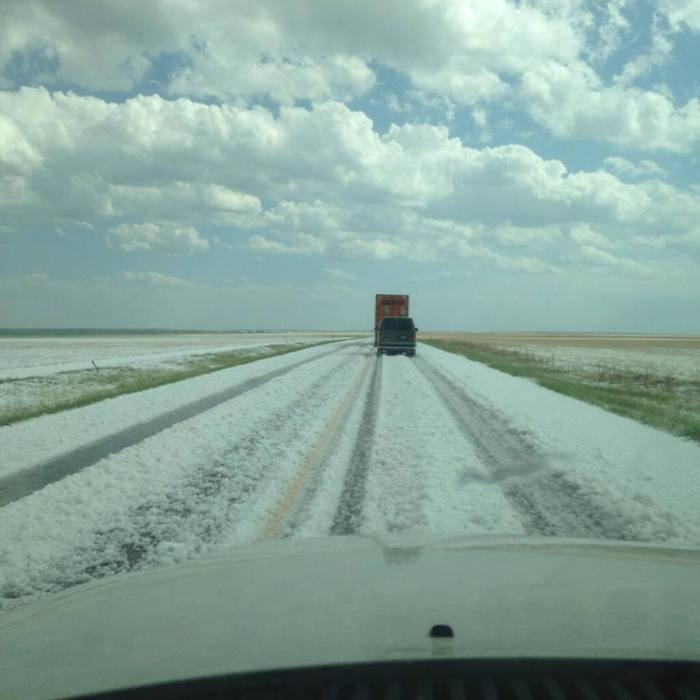 5-8-2014: A lot of accumulated hail along the highway 71 just south of Fort Morgan, Colorado. This storm is tornado warned as well as another one near Fort Collins, Colorado. Source: Matt Makens