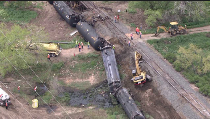 5-9-2014: LASALLE, Colo. — Six cars of a 100-car crude train derailed near LeSalle, Colo. Friday. Clean up crews were on scene to clear the derailment. Some crude oil leaked into a ditch, officials said. The train loaded in Windsor with Niobara crude and was headed to New York. The cars derailed around 8 a.m., officials said.