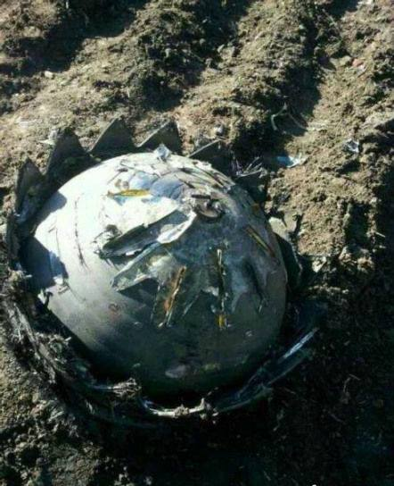 5-16-2014: Metallic ball that crash landed  - the Chinese village. in Heilongjiang, China.