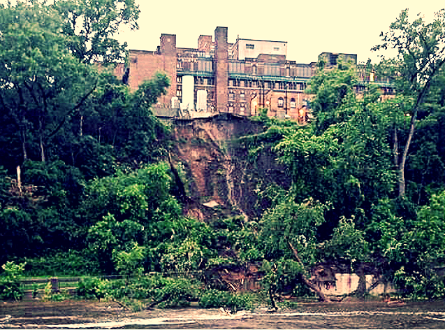 6-19-2014: A building on the University of Minnesota's Fairview Medical Center campus sat perched above a large mudslide and the Mississippi River Thursday night, the latest evidence that a week of rain in Minnesota has pushed Twin Cities over-saturated ground to its limits. The cliff collapsed in a mudslide above the West River Parkway, on the west bank of the Mississippi, and into the river.