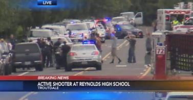 6-10-2014: TROUTDALE, OREGON -- Police responded shortly after 8 a.m. to a report of shots fired at Reynolds High School. Police confirmed about 9:20 a.m. that a shooter in the incident was dead. At 10 a.m., police confirmed that one student had also been killed. The students names and genders have not been released. SWAT teams were working their way through the school, releasing students from classrooms who are leaving with their hands over their heads.