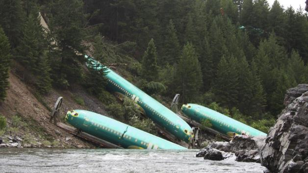 Thirteen of the cars that derailed were carrying freight, mostly aircraft parts. Via Imgur, www.imgur.com/gallery/EJVBCzL