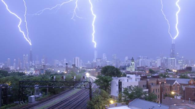 Photographer Craig Shimala was filming a time-lapse of a derecho over Chicago on the night of June 30th when a triple lightning strike touched down on three of the city's tallest buildings: Willis Tower, Trump Tower, and the John Hancock Building.
