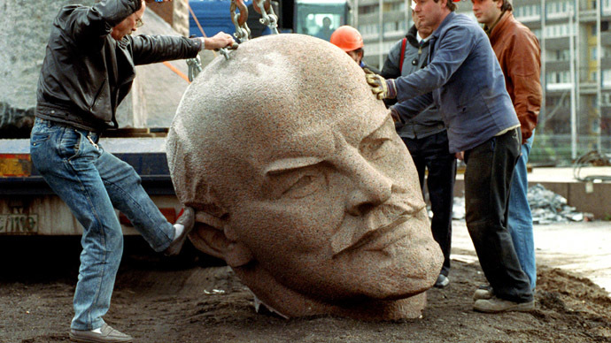 """Workers put on November 13, 1991 in Berlin to remove - using a crane - the granite head of the Russian revolutionary leader Lenin on the road. (AFP Photo/DPA) 8-23-2014: A piece of history lost, buried, or possibly stolen: German officials admitted they cannot locate Berlin's famous statue of Soviet leader Vladimir Lenin. Some claim the inability to find the monument is politicized – others boast having a """"treasure map."""" News of the missing cultural artifact came to light after the top of the statue – a 3.5-ton granite replica of the Russian revolutionary's head – was requested for an art exhibition, featuring monuments from Germany's Nazi and Communist eras."""