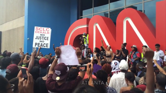 8-19-2014: Hundreds of protesters gathered outside the CNN center in Atlanta on Monday to march in memory of unarmed Missouri teenager Michael Brown who was gunned down by a police officer, many in protest of CNN's controversial coverage of the incident.