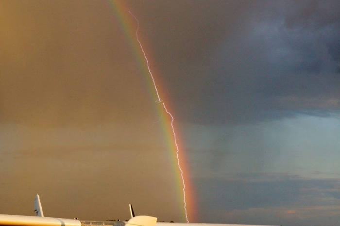 8-25-2014: Apparently this is a photo of a Boeing 777 en route from Frankfurt to Leipzig being hit by lightning over Leipzig airport. Also 'hit' by the rainbow! More at: Airmarini - Flugplatz Taucha (EDCT) - https://www.facebook.com/airmarini.de