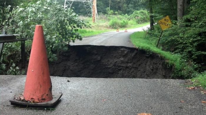 8-23-2014: A man died early Saturday morning after his vehicle went into a culvert in Perry Township. Heavy rain washed away part of Falbo Road, and the 37-year-old unknowingly drove into the 27-foot deep hole left behind, police said.