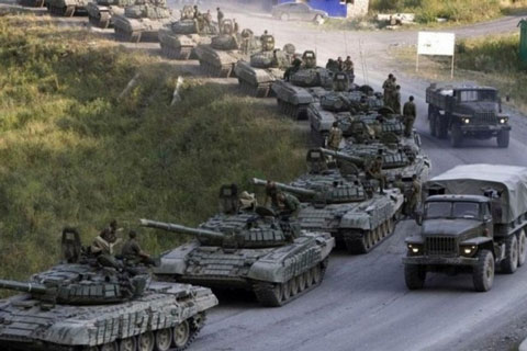 """8-5-2014: A massive buildup on the Ukrainian border in the last 48 hours has seen Russia double its troop levels with 17 additional battalions and has left Western leaders trying to figure out what President Vladimir Putin is planning to do next. On Tuesday the Russian President called for an emergency meeting of the United Nations Security Council to resolve the """"humanitarian crisis"""" in Ukraine that has reportedly left tens of thousands of people displaced because of fighting over the last several months, a move that some in the West see as prelude to a Russian invasion of Ukraine."""