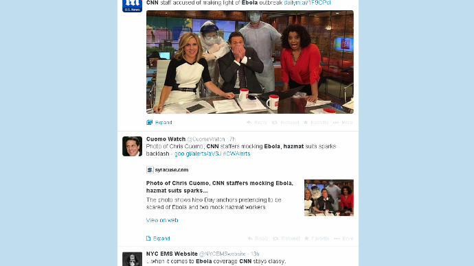A Twitter firestorm erupted after CNN tweeted a photo mocking the fear of Ebola while a congressional hearing took place on the crisis. It comes as 1,000 people are being monitored for symptoms in the US. The photo was posted by John Griffin, a senior producer at CNN, and shows three New Day anchors – Chris Cuomo, Michaela Pereira, and Alisyn Camerota – pretending to be scared while two men in protective gear stand over them. The post has since been removed. Social media users, particularly on Twitter, did not waste time reacting to the questionable post. For example, Addictinginfo.org slammed CNN for tweeting an image mocking the Ebola crisis.