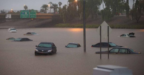 9-8-2014:  A major storm packing heavy rains pounded the Phoenix area early on Monday, forcing schools to cancel classes and closing roads including sections of two major freeways. The downpour brought chaos to the morning commute for many, turning some highways into lakes, with officials saying parts of both Interstates 10 and 17 were shut to traffic. Arizona Governor Jan Brewer declared a statewide emergency for areas affected by the severe rainfall and flooding.