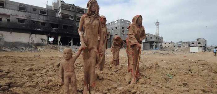 10-20-2014: Palestinian artist Iyad Sabbah displays clay figures on the beach in Gaza portraying the civilians' suffering during the recent war with Israel.