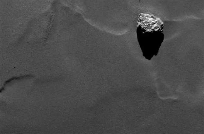 "The European Space Agency's Rosetta spacecraft has sent home several spectacular images that show a large pyramid-shaped boulder studding the surface of its target comet. This Satellite Is Landing an a Comet! There's a satellite that's been traveling for nearly a decade in outer space, and it's about to land on a comet! In this week's Space news, Trace explains how this amazing feat of engineering is going to be pulled off. Rosetta mission team members have named the 82-foot-tall (25 meters) boulder on Comet 67P/Churyumov-Gerasimenko ""Cheops,"" after the largest pyramid in Egypt's famous Giza complex. The rock is much smaller than its namesake, however, which rises 456 feet (139 m) into the Egyptian sky."
