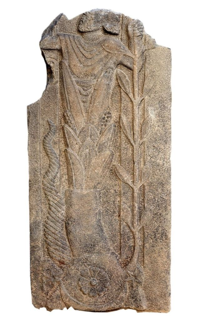 """A sculpture of a mysterious, never-before-seen Roman deity has been unearthed in an ancient temple in Turkey. The 1st century B.C. relief, of an enigmatic bearded god rising up out of a flower or plant, was discovered at the site of a Roman temple near the Syrian border. The ancient relief was discovered in a supporting wall of a medieval Christian monastery. """"It's clearly a god, but at the moment it's difficult to say who exactly it is,"""" said Michael Blömer, an archaeologist at the University of Muenster in Germany, who is excavating the site. """"There are some elements reminiscent of ancient Near Eastern gods, as well, so it might be some very old god from before the Romans."""""""